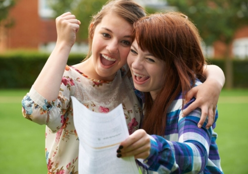 Two students celebrate exam success
