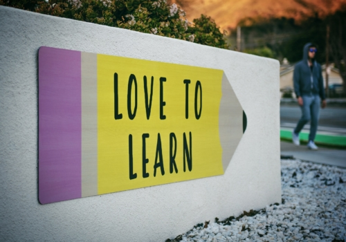 Arrow with caption 'Love to Lean' and a man walking past it